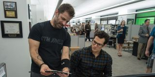 Zack Snyder working with Henry Cavill on the set of Batman v Superman