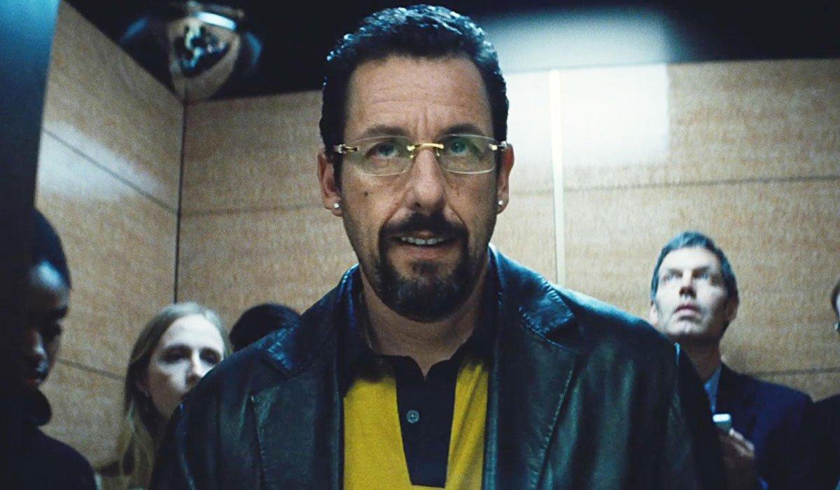 Adam Sandler As Howard Ratner Walking Out Of An Elevator In Uncut Gems