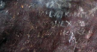 Written in Greek, the curse on this lead tablet targets Demetrios and Phanagora who were husband-and-wife tavern keepers who lived in Athens around 2,400 years ago.