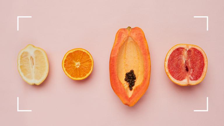 fruit vagina concept on pink background
