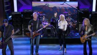 Miley Cyrus performing alongside Metallica