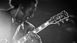 A photo of Chuck Berry on stage