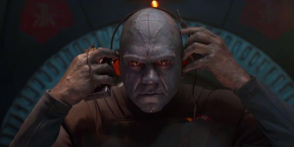The blue Kyln employee listening to Star-Lord's Walkman in Guard