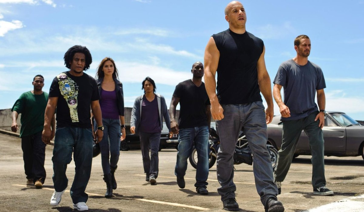 Fast Five Vin Diesel and Paul Walker lead their family on the tarmac