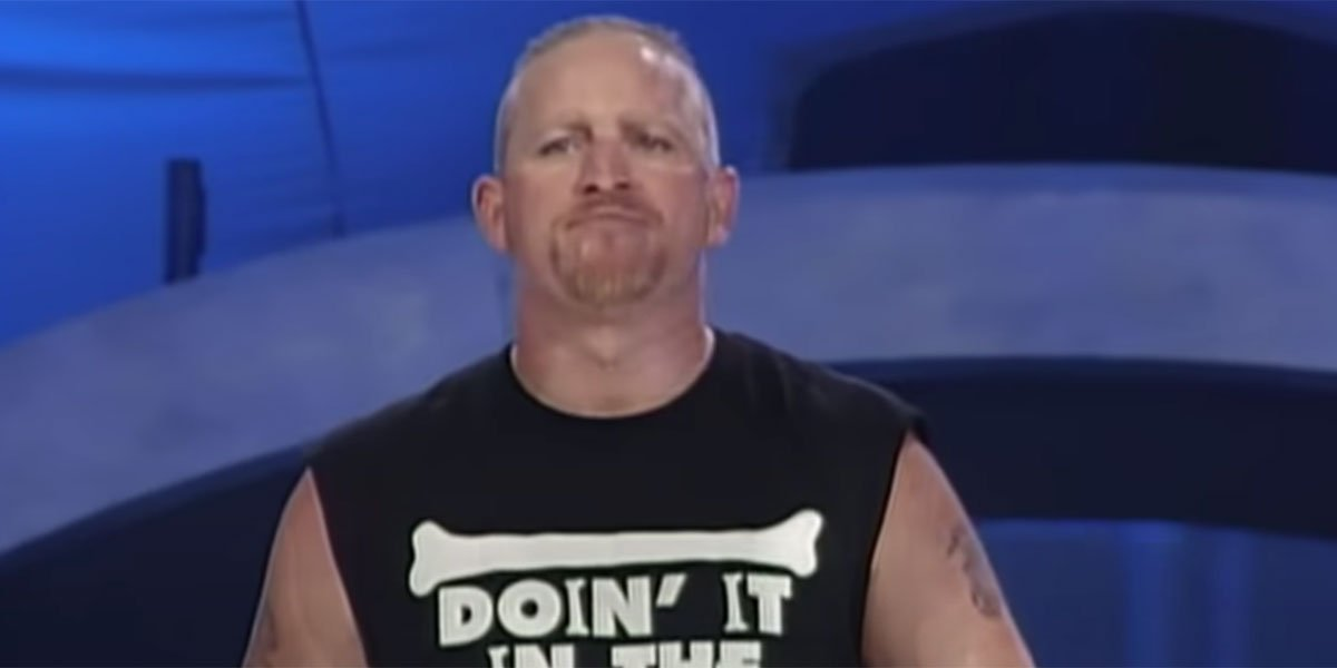 WWE wrestler Jesse James walking out of the entrance ramp during a WWE event with a cut off Road Dogg t-shirt on.
