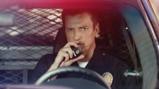 Nathan Fillion as Officer John Nolan in The Rookie.