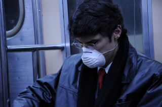 guy with mask to prevent influenza