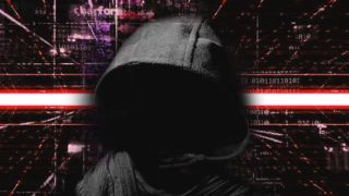 A hooded figure over a red and black cyber background