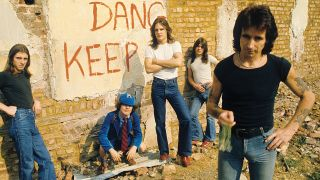 A photograph of AC/DC taken outside in a building site