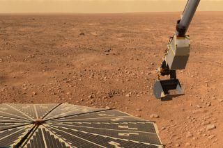 NASA's Phoenix Mars Lander Scooping Soil