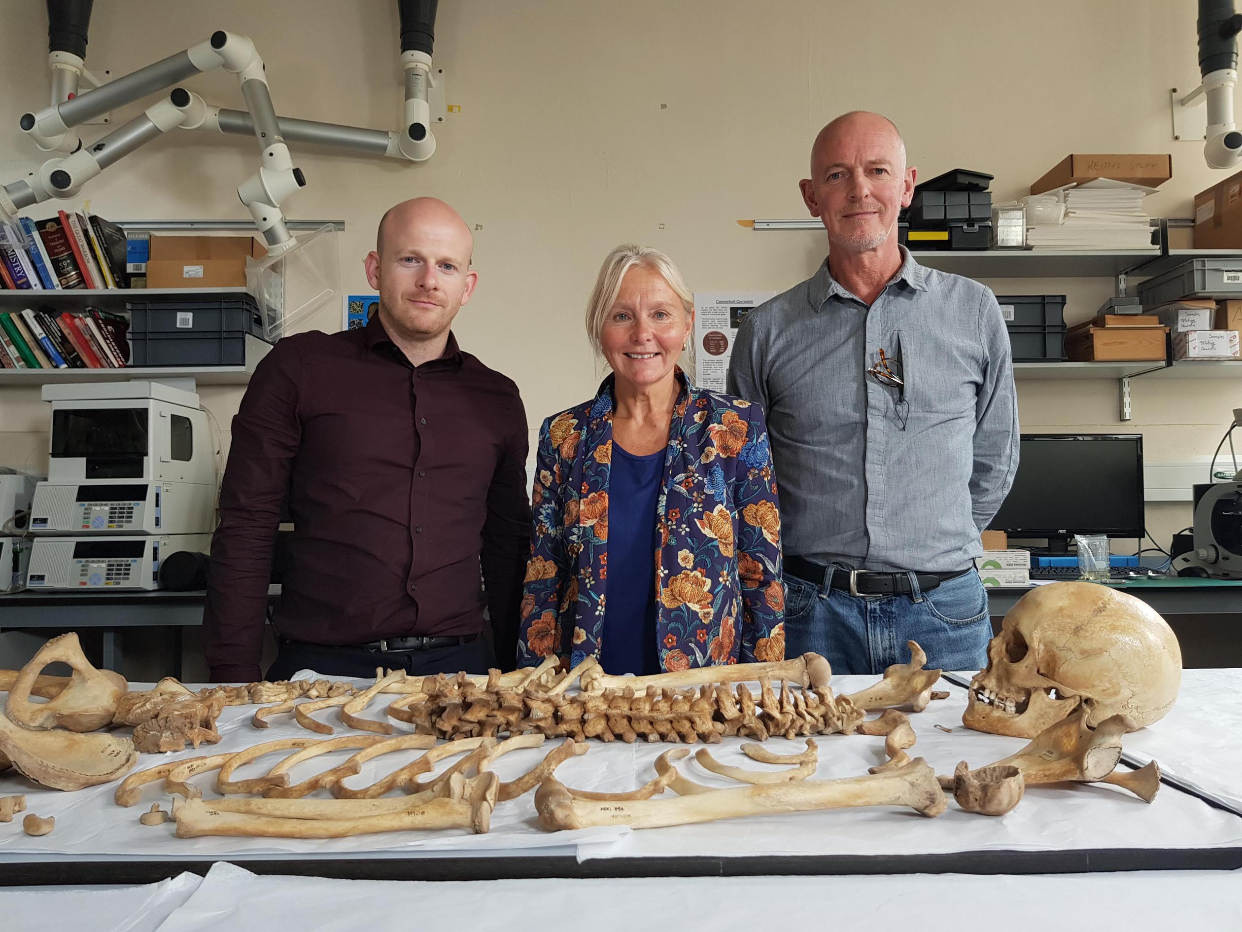 Skeletons of the Mary Rose: Dr Richard Madgwick, Alex Hildred and Nick Owen examining the skeleton from the Mary Rose