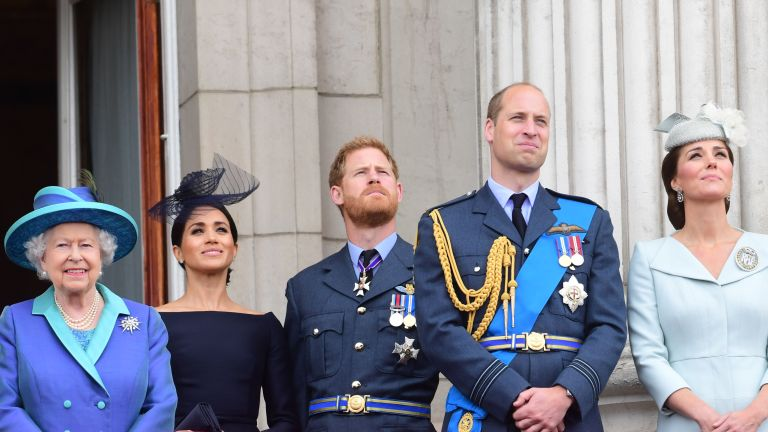 Prince Harry Meghan Markle Prince William Kate Middleton and the Queen - watch the RAF 100th anniversary flypast from the balcony of Buckingham Palace on July 10, 2018