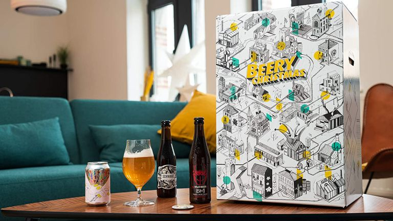 "Best advent calendar for beer lovers: Beer Hawk ""Beery Christmas"" Craft Beer Advent Calendar on table with snacks and beers"