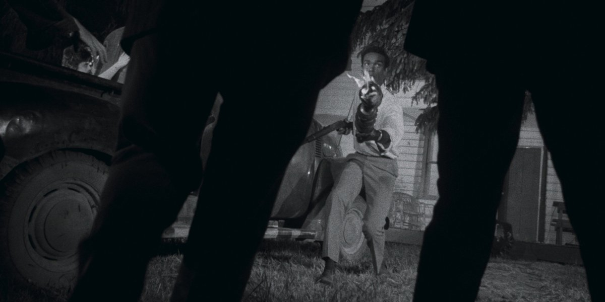 Duane Jones shoots at a pair of zombies in Night Of The Living Dead
