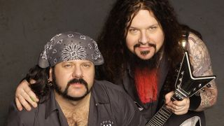 Vinnie Paul and Dimebag Darrell posing at a Damageplan session