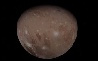A screenshot from a new video showing the June 2021 flybys of Jupiter and its largest moon, Ganymede, by NASA's Juno probe. This image shows Ganymede, the largest moon in the solar system.
