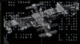 The spacecraft Soyuz MS-14 approaches the International Space Station during the docking process on 26th August 2019.