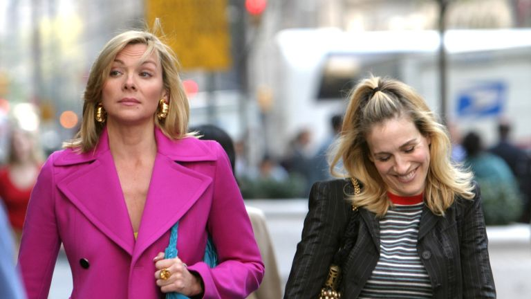 """Kim Cattrall and Sarah Jessica Parker during Kim Cattrall and Sarah Jessica Parker On Location For """"Sex And The City"""" at Saks Fifth Ave in New York, New York, United States. (Photo by James Devaney/WireImage)"""