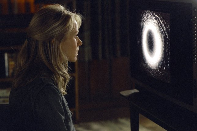 Naomi Watts watches the cursed videotape in The Ring