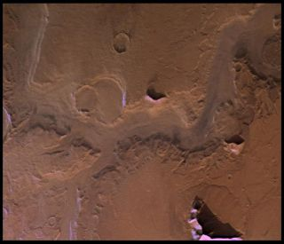 An image of Reull Valles on Mars, where new research identifies characteristics consistent with meltwater channels flowing between ground and glacier.