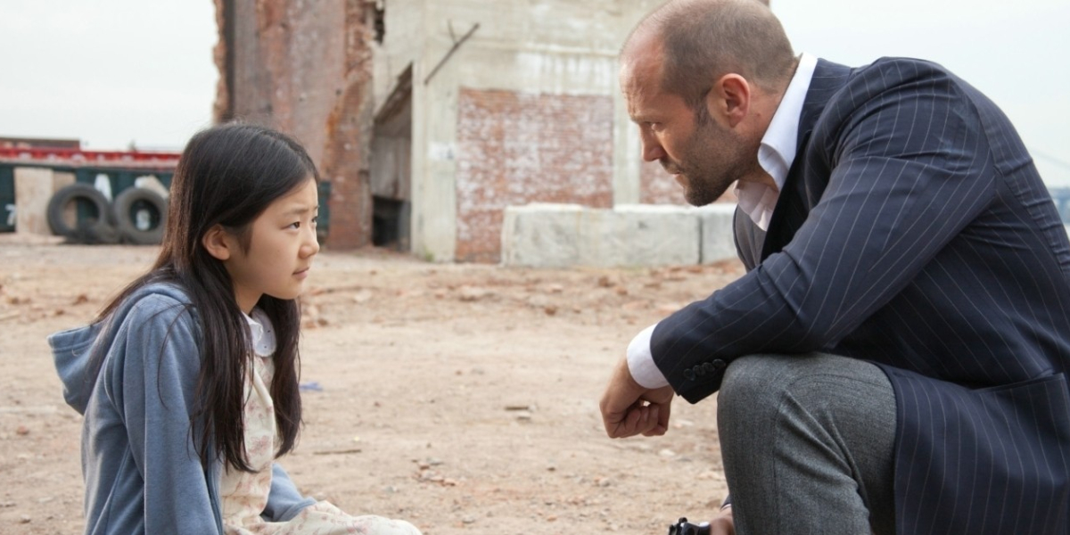 Catherine Chan and Jason Statham in Extraction