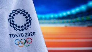 Tokyo Olympics 2020 logo in front of an athletics track
