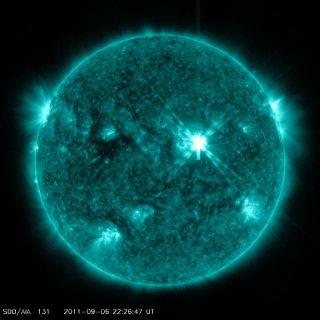 This image taken by NASA's Solar Dynamics Observatory watching the sun shows a powerful solar flare (center right) on Sept. 6, 2011.