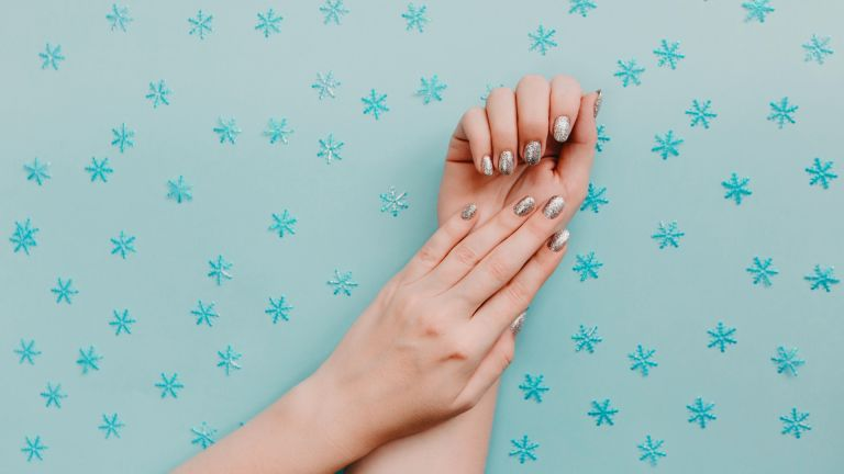 Sparlky manicure on backdrop of stars