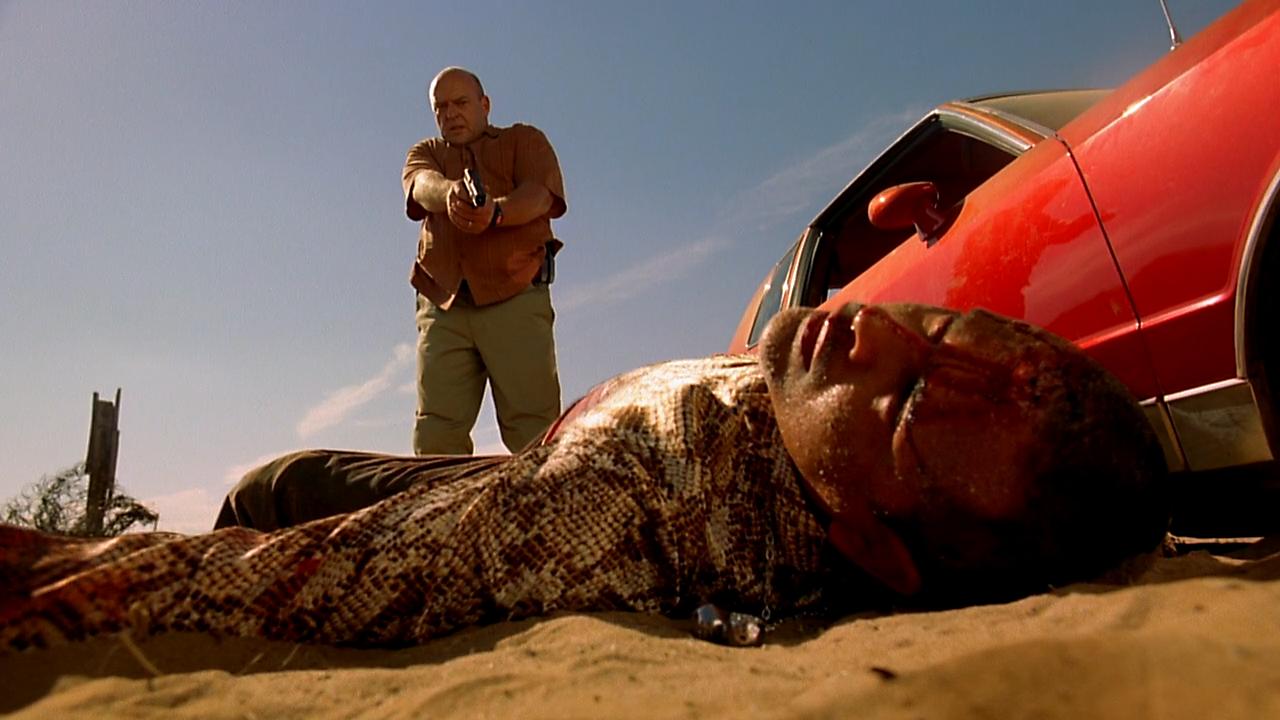 Dean Norris with the gun, Raymond Cruz in the dirt