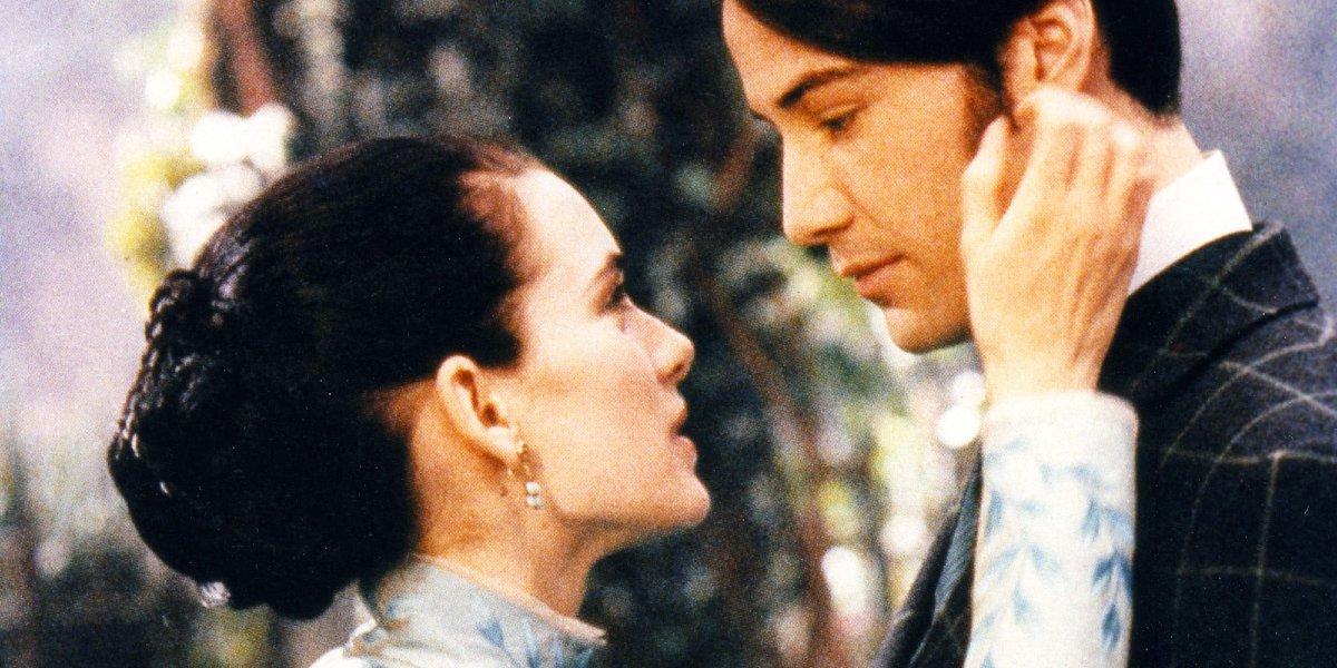 Bram Stoker's Dracula Winona Ryder holds Keanu Reeves cheek in her hand
