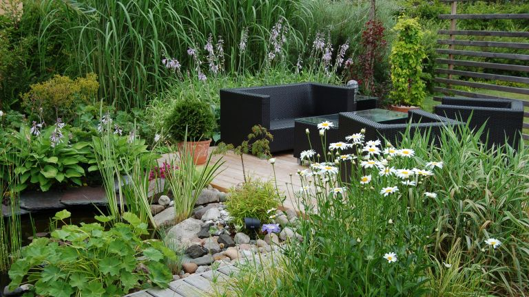 Edging plants: decking and pond with planting