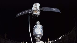 Image shows the Russian-built module Zarya (top) being aligned to attach to the U.S. module Unity in 1998