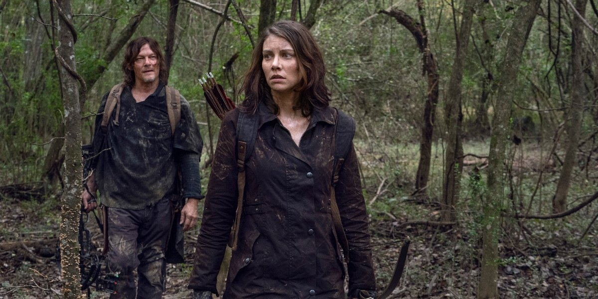 Maggie and Daryl walking alongside each other in the woods.