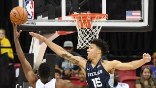 Kelan Martin #30 of the Minnesota Timberwolves puts up a shot against Brandon Clarke #15 of the Memphis Grizzlies during the championship game of the 2019 NBA Summer League at the Thomas & Mack Center on July 15, 2019 in Las Vegas, Nevada.