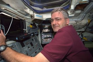Marc Garneau at Controls of Canadian Robotic Arm