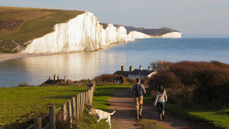 Dog walkers on the Seven Sisters Cliffs, perfect UK lockdown stroll