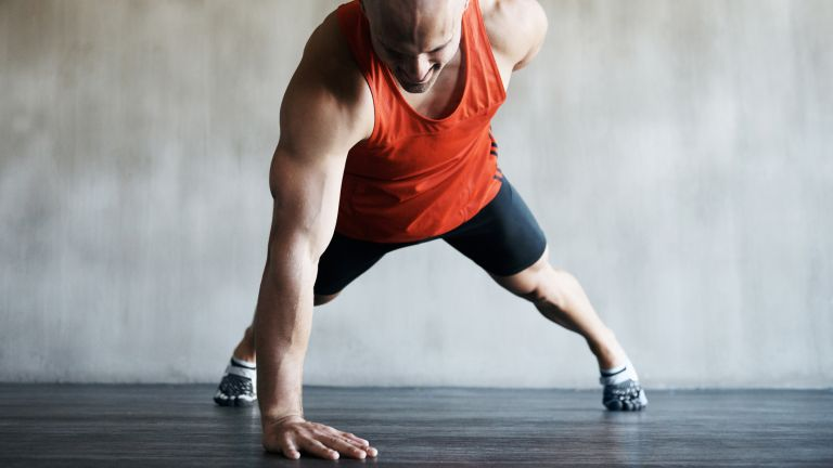 Man doing a one-arm push up