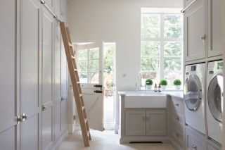 a utility room idea with a library ladder