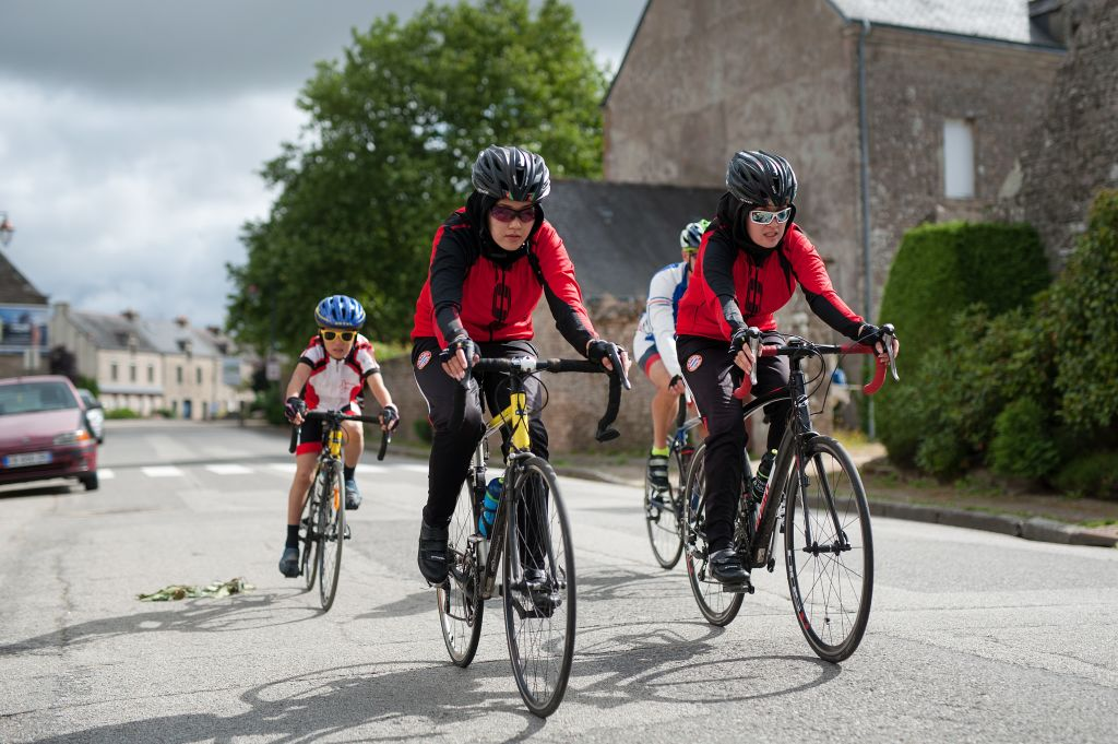 Afghanistans riders Masomah front L and Zahra Alizada front R take part in a cycling training session with their little brother Ali Reza rear L on June 28 2017 in Guehenno western FranceMasomah and Zahra Alizada two Afghan refugees passionate about cycling and in danger in their country of origin were welcomed in Brittany by the French family of Thierry Communal Their dreams participate in the Olympic Games in Tokyo in 2020 and become the first Afghan women medallists AFP PHOTO JEANSEBASTIEN EVRARD Photo credit should read JEANSEBASTIEN EVRARDAFP via Getty Images