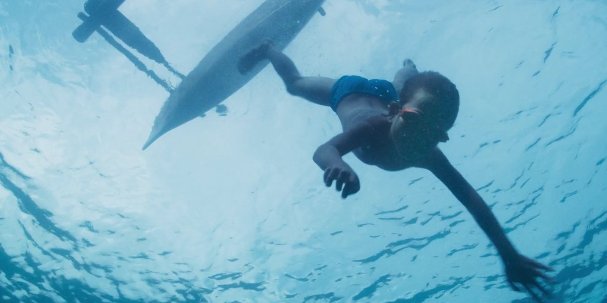 A young boy takes a dive into the ocean on A World Of Calm