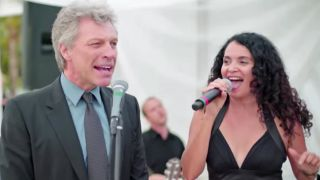 A picture of Jon Bon Jovi and Lourdes Valentin performing at a wedding in Miami
