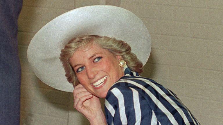 Princess diana smiling in large brim hat