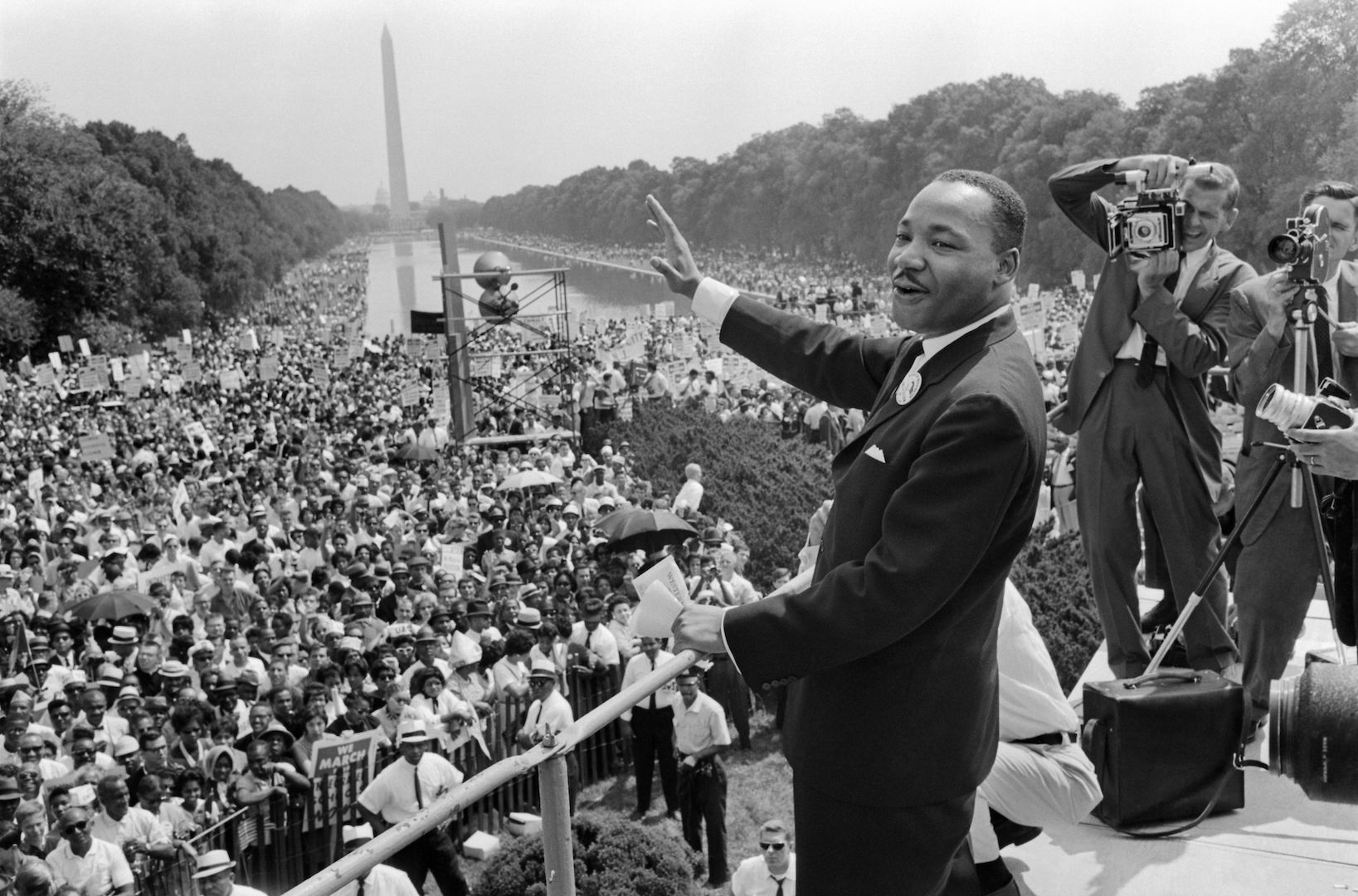 """The civil rights leader Martin Luther King Jr. waves to supporters on Aug. 28, 1963 on the Mall in Washington D.C. (Washington Monument in background) during the """"March on Washington."""""""