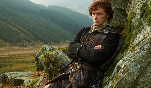 jamie fraser with arms crossed outlander