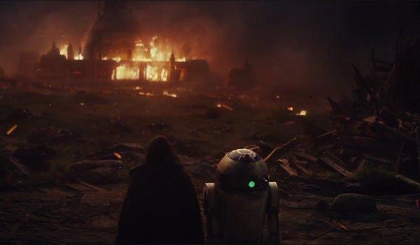 R2-D2 looks over flaming destruction the last jedi