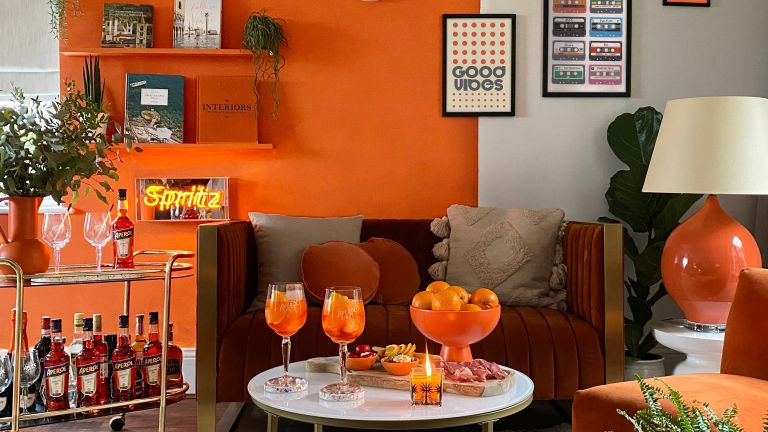 Aperol A Casa Capsule, orange interior collection by Aperol, living room designed by Italian liquor manufacturer