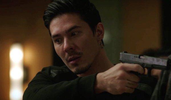 Zhou Cheng holding gun on iron fist