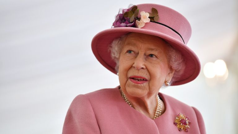 The queen in pink hat and outfit