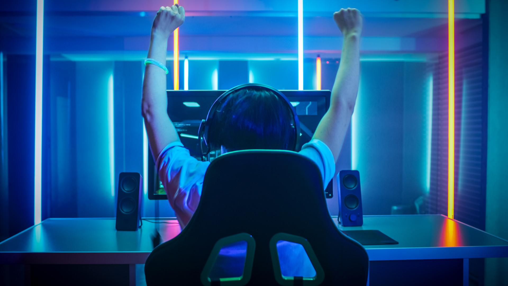Happy PC gamer celebrating