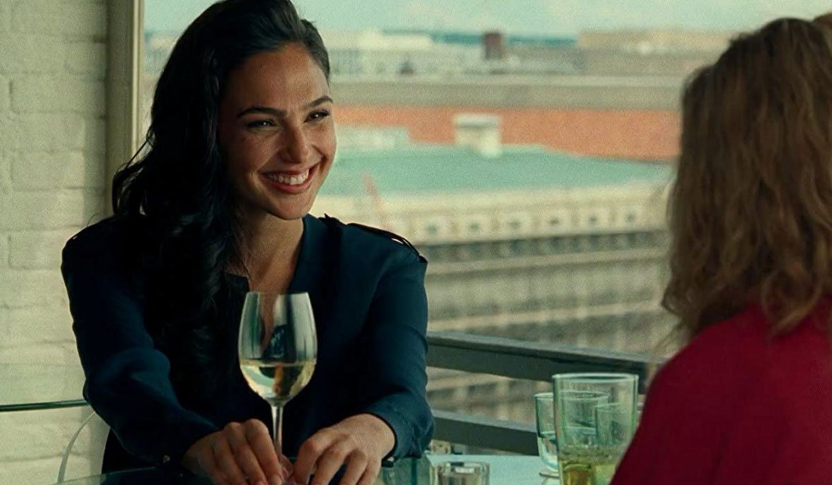 Wonder Woman drinking some wine and having lunch.